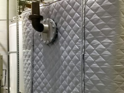 AECOM Industrial Plant - Acoustical blanket wall using AudioSeal® blankets to block noise from equipment, reducing the noise for the employees in plant.