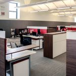 Agati Furniture - Open office plan using red AlphaSorb panels and Sonex® Whisperwave clouds in ceiling.