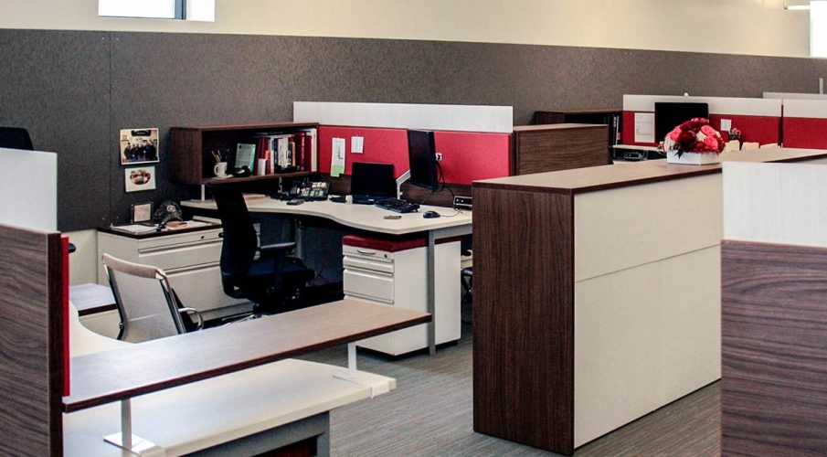 Agati Furniture - Open office plan using red AlphaSorb® panels and Sonex® Whisperwave® Clouds in ceiling.