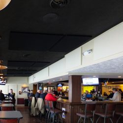 American Legion Post #28 installed a series of black and white acoustic panels on the walls and ceiling of their bar and dining area.