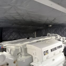 Watercraft / Boat Engine - Engine compartment of a diesel powered boat lined with barrier and absorber acoustic blankets.