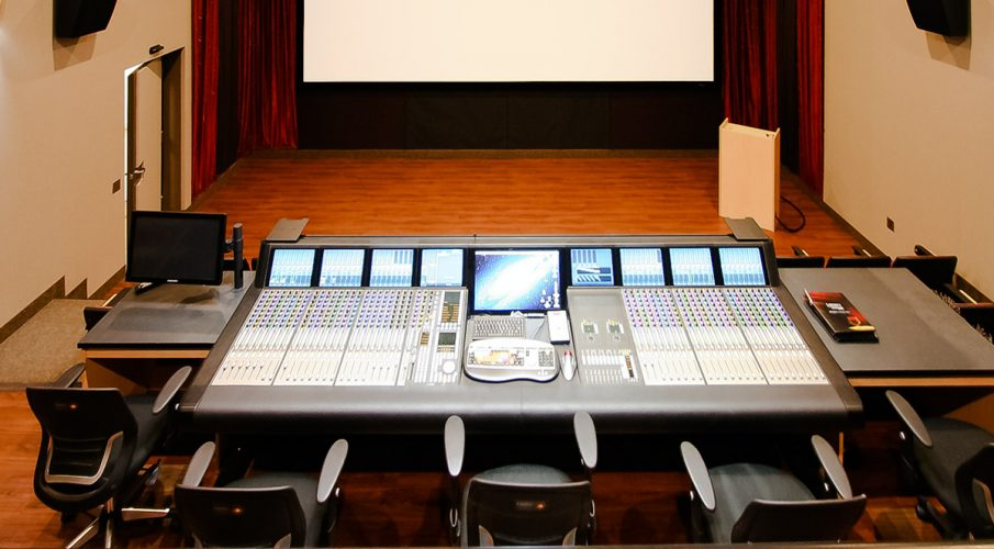 Liberty University Mixing Room using Stretch wall system for side wall acoustics and speaker covers under the screen.