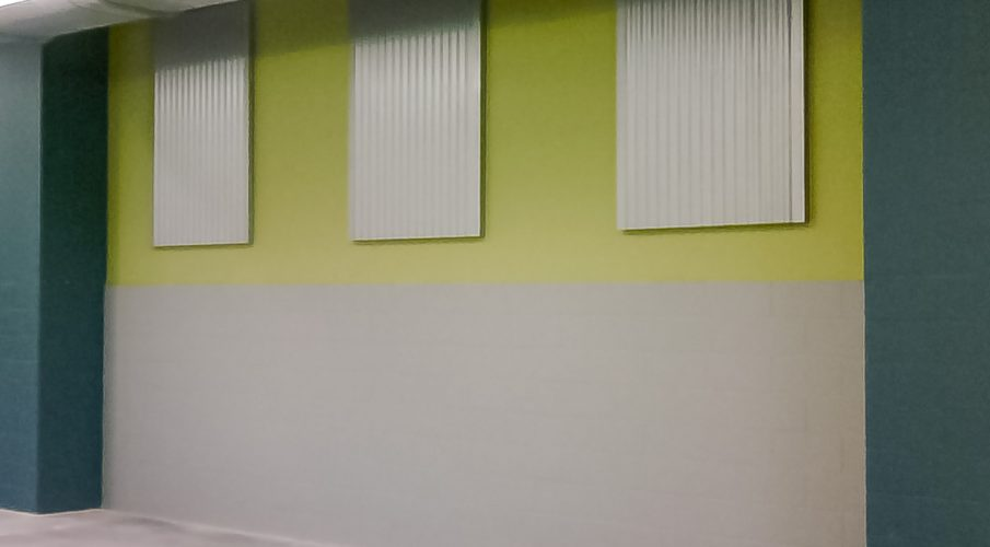 Shaw Modular Solutions using AlphaPerf® panels for industrial look to reduce room noise in school cafeteria.