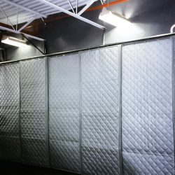 Steel Fabricator - In plant acoustical wall for reducing equipment noise using AudioSeal® Barrier and absorber blankets.