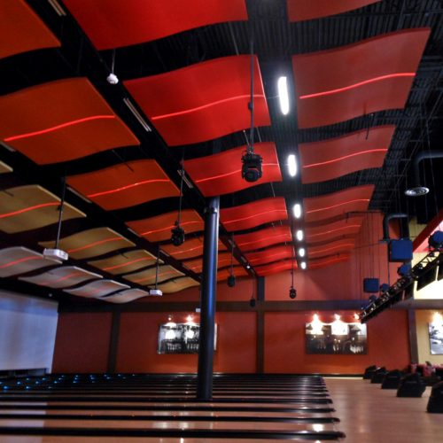 The WhisperWave Clouds by Pinta Acoustic, Inc. in this application photo were customized to fit the design and theme of this this bowling alley theater.