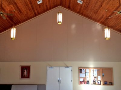 Saint Peter's Catholic Church -Custom manufactured fabric wrapped panels sized to fit an angled ceiling