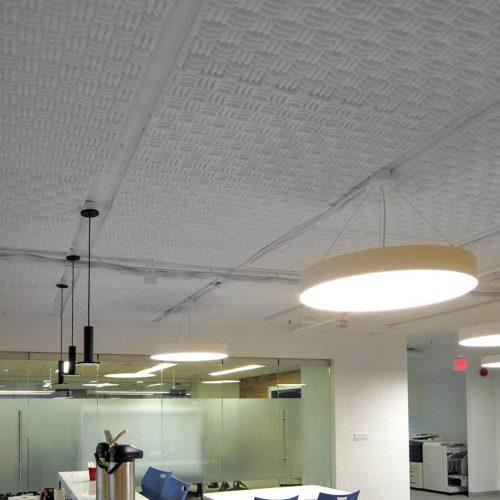 Internews - Sonex® Classic acoustical foam in Natural White installed direct to the ceiling.
