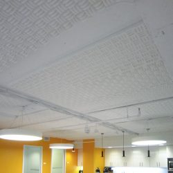 Internews - Sonex® Classic acoustical foam in Natural White installed direct to the ceiling to reduce echo.