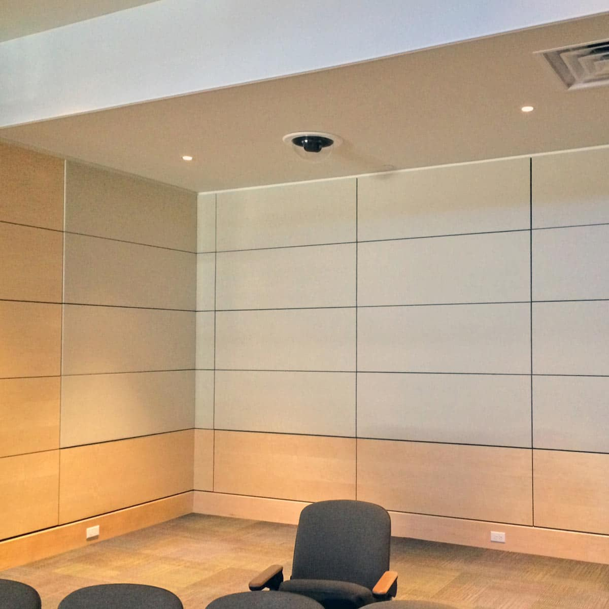 AcoustiWall Fabric Stretch System Installed At Stryker Center Appears Above  The Standard Fabric Wrapped Acoustical Panels