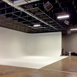 The sound absorbing baffles installed above the Cyclorama Wall at Spang TV reduce echo and improve the room acoustics.