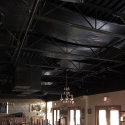 Cane Rosso Pizzeria installed black PVC banners that blend into the ceiling while reducing the sound levels in their award-winning restaurant.