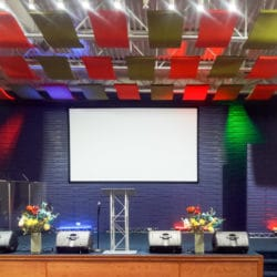 A combination of HPC Coated Colors create a unique look for these Whisperwave® Clouds in the sanctuary at the Christ Healing Evangelical Church in South Holland, IL. Pictured are 2'x4' clouds in olive green and orange red.