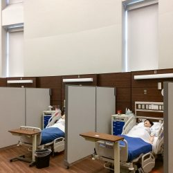 Collin College Healthcare SIM Lab - The panels in theses portable dividers help improve communication between the instructors and student through the intercom system.