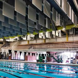 A series of 4' x 4' PVC Baffles installed at the Ridgefield Aquatic Club Pool to lower the reverberation and to improve the communication efforts between the coaches and athletes.