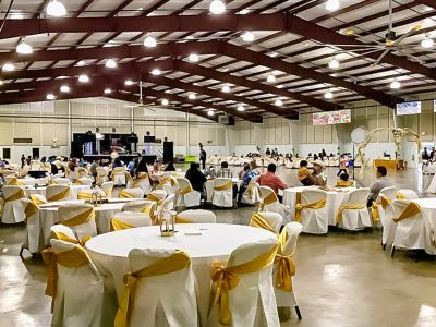 Fannin County Multipurpose Complex using fabric wrapped panels around the perimeter of the room.