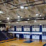 AlphaSorb® High Impact Acoustic Panels and AlphaFlex® PVC Ceiling Banners installed in the Forsythe County School Gymnasium to improve the room acoustics.
