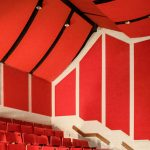The SoundSuede™ Acoustic Panels at Glouster High School Auditorium soften the sound with a theater styled design.