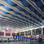 AlphaFlex® PVC Ceiling Banners and AlphaEnviro® PVC Acoustic Panel completely turned this Natatorium (Indoor Pool) into a great sounding and super functional space.