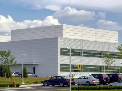 The sound barrier wall system implemented at BMW North America secretly quiets and hides the noisy rooftop equipment.