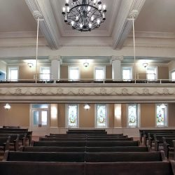 The AlphaSorb® Acoustic Panels along the back wall Centenary United Methodist Church blend in with the decor and prevent sound from echoing around the sanctuary.
