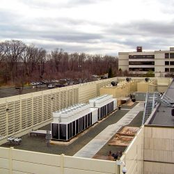 Nomura Securities appeased local noise ordinances by adding an IAC Acoustics Noishield® Sound Barrier system that included custom louvers to allow for airflow to the rooftop equipment.