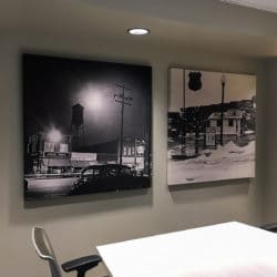 City of Broken Arrow improved their conference room acoustics with fabric wrapped panels and art panels featuring historical photos.